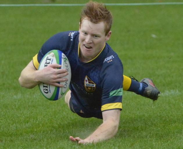 Dunedin outside back Rory Ward scores in the corner during his team's Dunedin premier club rugby...