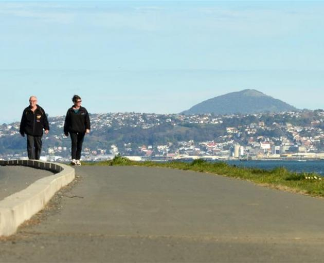 Selwyn and Pam Chalmers, of Macandrew Bay, enjoy a stroll on a completed section of the Otago...