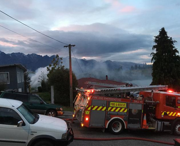 Smoke rises from a sleepout fire in Suburb St. Photo: Miranda Cook