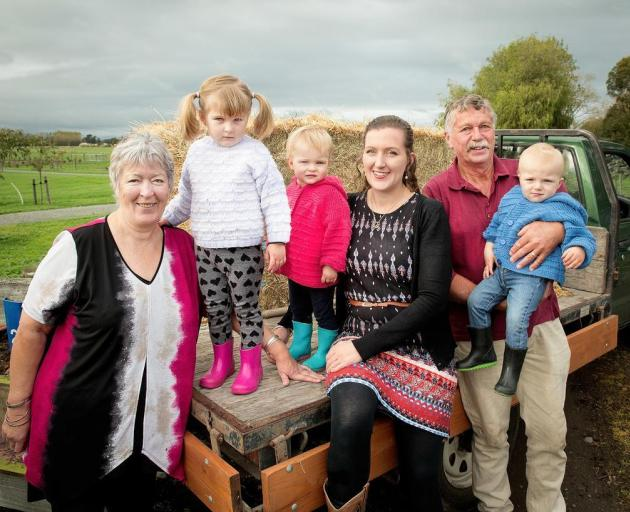 Judy and Murray Collins with their daughter Jenny Broomhall and grandchildren Elsie Broomhall, 3, and 19-month-old twins Leila and Henry Broomhall have celbrated 150 years in farming. Photo: Star.Kiwi