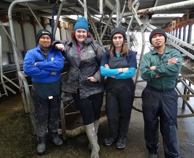 Sharemilker and South Island Dairy Event committee member Amy Johnston (second left), of Lorneville, is keen to encourage farm workers to attend BrightSIDE, a segment of the dairy conference for farm workers. She is pictured with farm manager Elizer Barbo