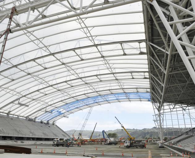 The covered stadium's roof takes shape in late 2010. PHOTO:GERARD O'BRIEN