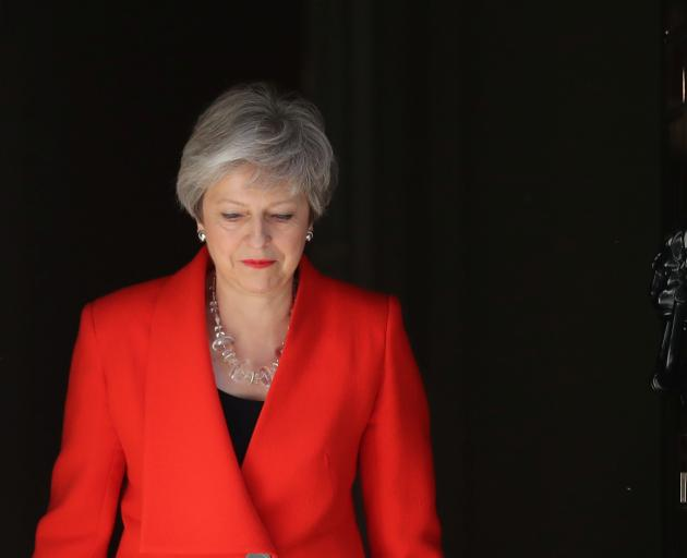 British Prime Minister Theresa May arrives to deliver a statement in London. Photo: Reuters