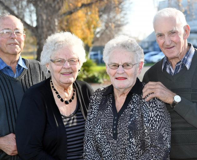 Balclutha twins Diana Tweed (right) and Deanna Benington, and their respective husbands Gilbert and Robin, celebrate a shared 60th wedding anniversary today. Photo: Stephen Jaquiery
