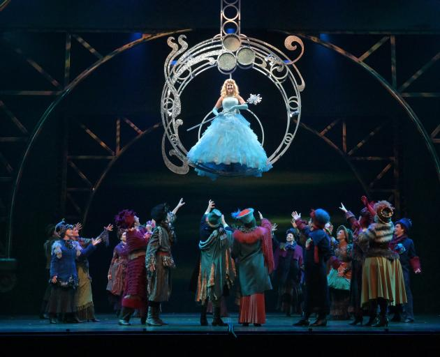 Kelly Hocking (Glinda) soars above the chorus in the opening number of the Musical Theatre...