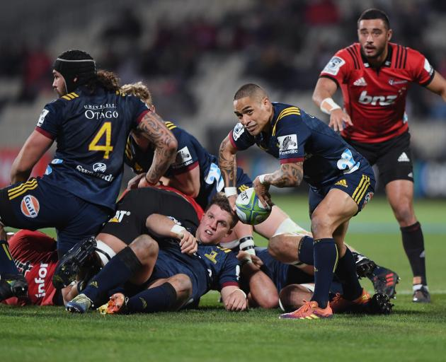 Highlanders halfback Aaron Smith about to clear the ball from a ruck.PHOTO: GETTY IMAGES