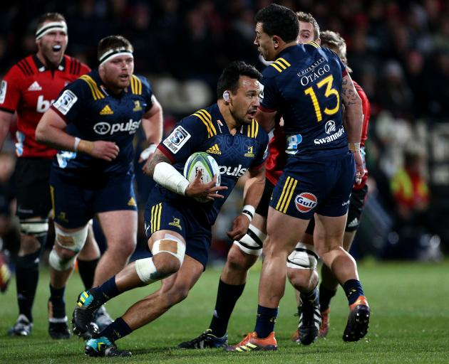 Highlanders hooker Ash Dixon makes a break with ball in hand. PHOTO: GETTY IMAGES