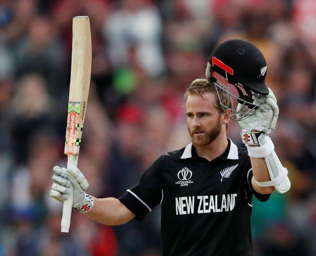Black Caps skipper Kane Williamson salutes the crowd after bringing up his century in his side's...