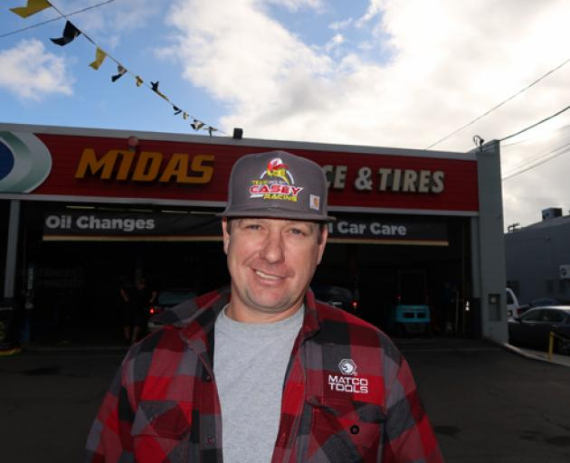 Casey in front of his Midas automotive repair shop in San Diego. Photo: Supplied