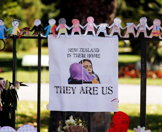 A poster hangs at a memorial site in front of Christchurch Botanic Gardens for victims of the Christchurch shooting. Photo: Reuters