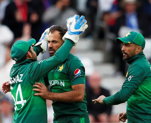 Pakistan's Wahab Riaz celebrates the wicket of England's Chris Woakes. Photo: Reuters