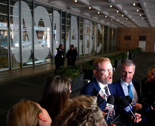 Editorial Director of the ABC Craig McMurtie speaks to members of the media after police raided...