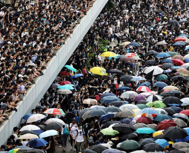 Protesters march along a road demonstrating against a proposed extradition bill in Hong Kong....