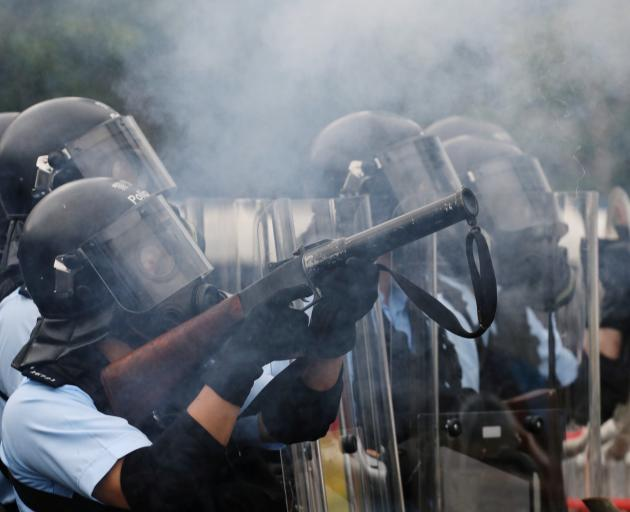 Hong Kong police fire tear gas at protesters during the ongoing demonstrations. Photo: Reuters