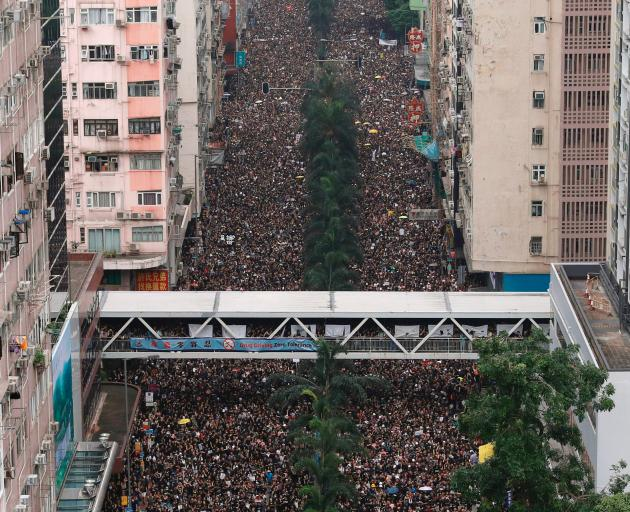 Protesters attend a demonstration demanding Hong Kong's leaders to step down and withdraw the...