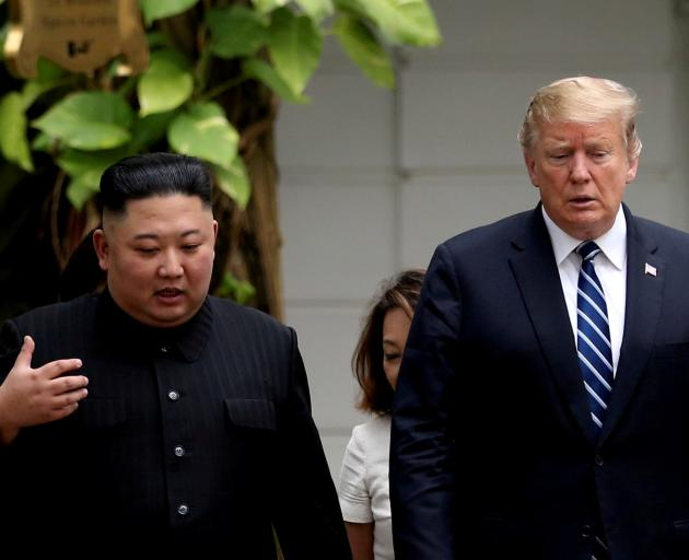 Kim Jong-Un and Donald Trump speak during their ill-fated meeting in Hanoi in February. Photo:...