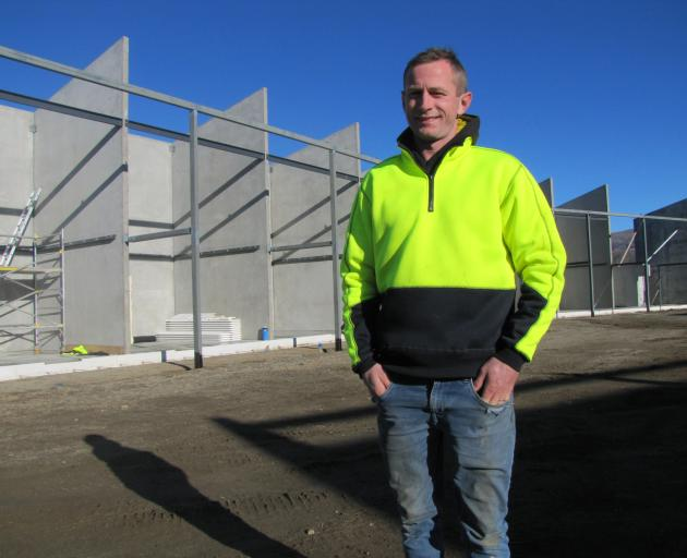 General Construction manager Bryce Geary is flanked by stage one of the $10 million dollar AC/JV...