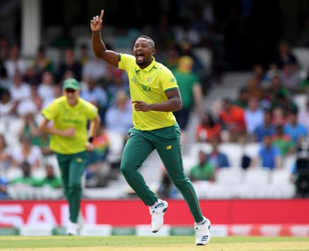 South African all rounder Andile Phehlukwayo celebrates taking a wicket against Bangladesh...