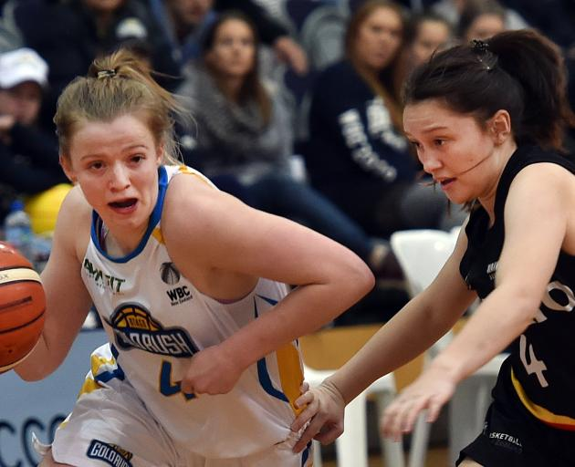 Otago Gold Rush guard Aleisha Ruske dribbles past Quaye Walker-Eketone of the Waikato Wizards...