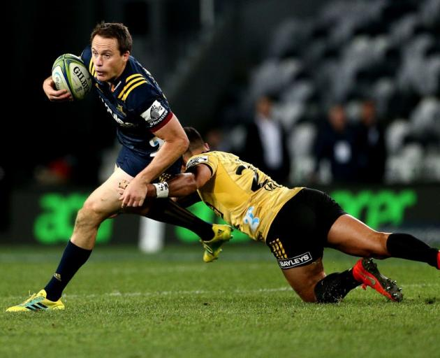 Ben Smith on the run for the Highlanders against the Hurricanes last week. Photo: Getty Images