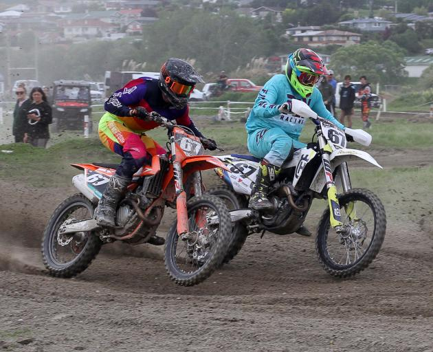 Madison Latta, of Balclutha (right), passes Liam Shepherd, of Invercargill, on his way to MX2 Southern Series victory at Balclutha last year. Latta is a finalist in tonight's Clutha Licensing Trust Sports Awards. Photo: John Cosgrove