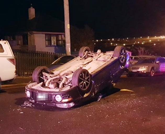A car rolled after hitting two parked cars in Calton Hill yesterday. Photo: Kris Campbell