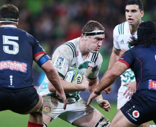 A bloddied Brodie Retallick runs with the ball during the match between the Rebels and the Chiefs. Photo: Getty Images