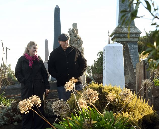 Dunedin woman Deirdre Cooper and her father Peter Duncan with the marble headstone of Mr Duncan's...