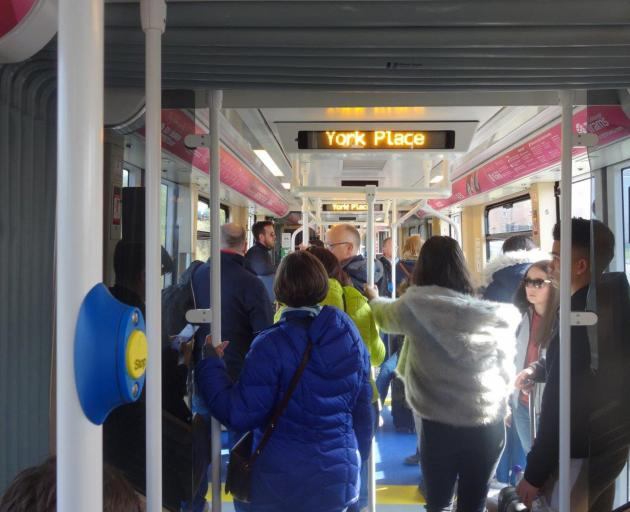 Passengers stand in a tram heading for York Pl, Edinburgh. Photo: Bill Campbell