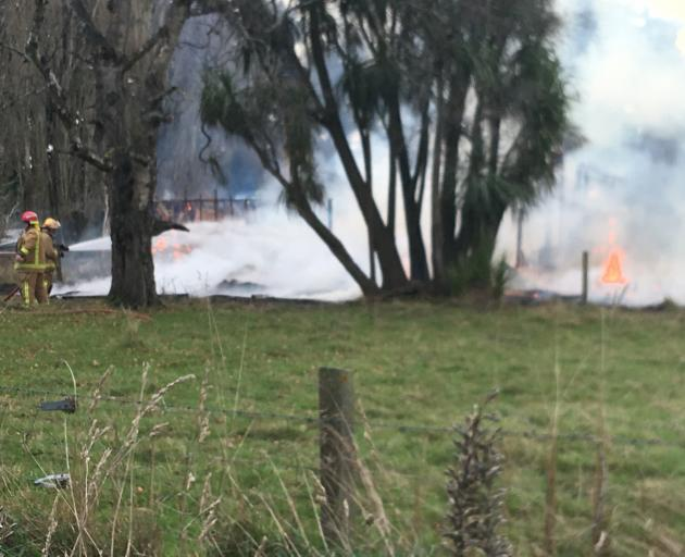 Firefighters work to contain the blaze. Photo: John Cosgrove