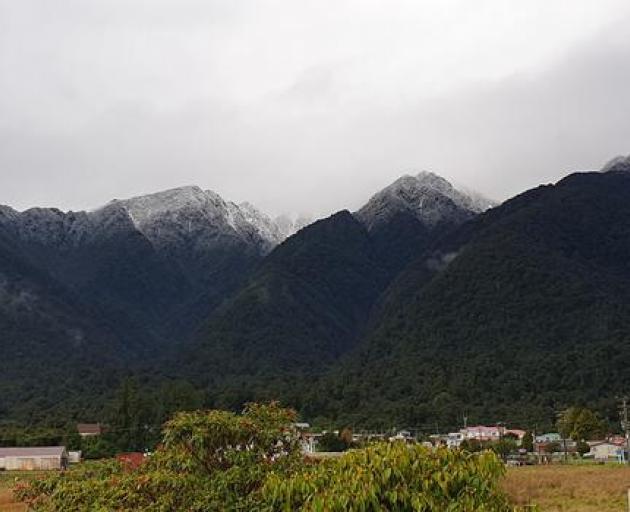 Fox Glacier township overshadowed by mountains Photo: RNZ / Tess Brunton