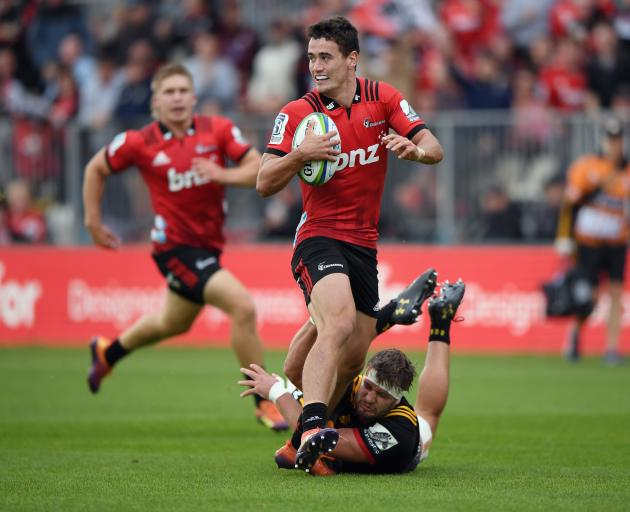 Crusaders fullback Will Jordan eases through a tackle. Photo: Getty Images