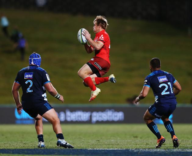 Former Highlanders first-five Hayden Parker (centre) has had a strong season for the Sunwolves....