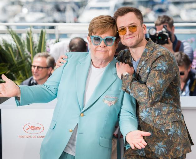 """Elton John and Taron Egerton attend the photocall for """"Rocketman"""" during the 72nd annual Cannes..."""