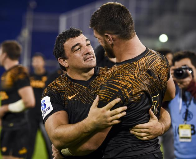 Jaguares players Agustin Creevy and Marcos Kremer share a tender moment after their team's Super...