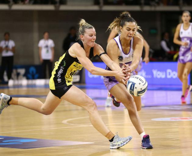 Central Pulse captain Katrina Rore competes with Northern Stars centre Holly Fowler for the ball...