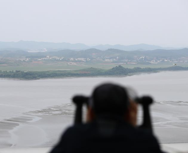 A visitor looks look over toward North Korea at the Unification observation post, near the...
