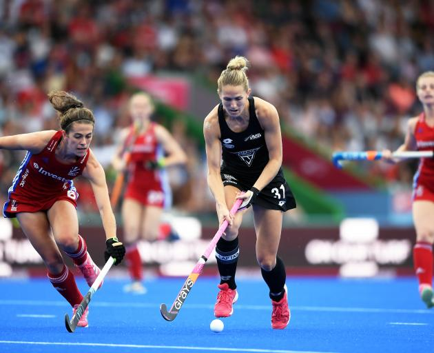 New Zealand women's Black Sticks player Stacey Michelson makes a break against Great Britain...
