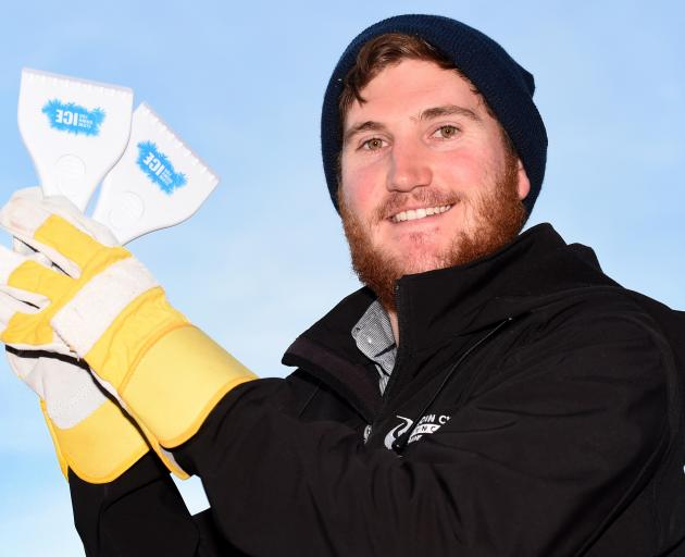 Roading engineer Jacob Manson with some free scrapers the Dunedin City Council is supplying to combat ice on winter windscreens. Photo: Gregor Richardson
