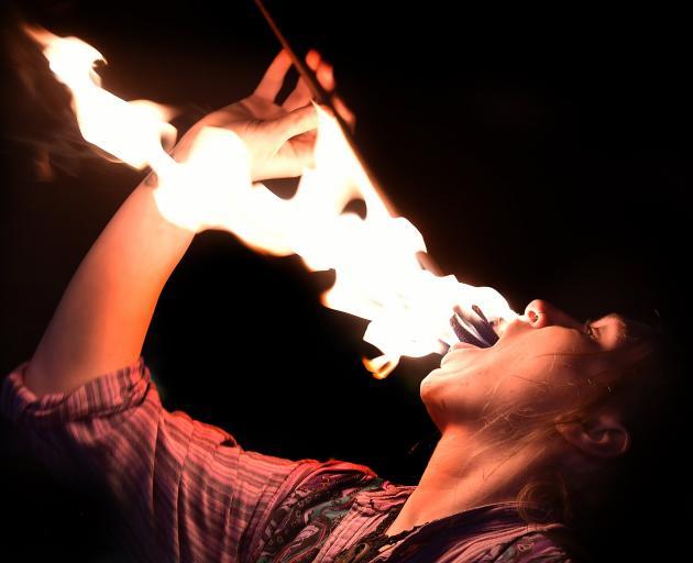 Lauren Dance ''eats'' fire. PHOTOS: PETER MCINTOSH