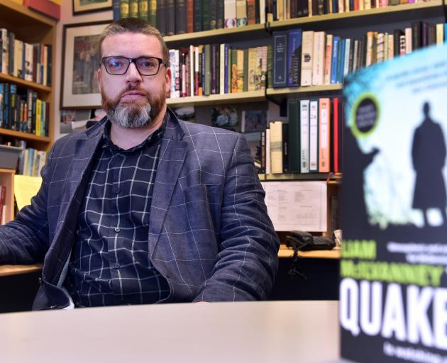 Liam McIlvanney in his office at the University of Otago, with The Quaker. PHOTO: PETER MCINTOSH