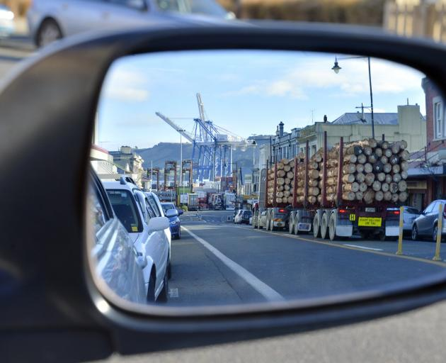 A log truck rumbles through the main street of Port Chalmers on its way to Port Otago's wharf....