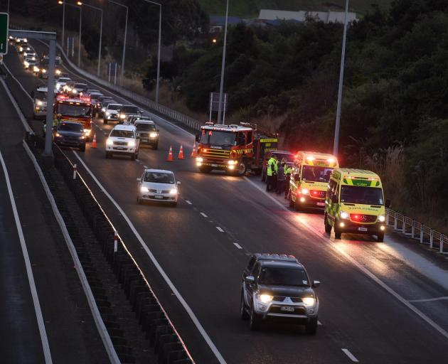 Emergency services at the scene of the crash on the motorway. Photo: Stephen Jaquiery