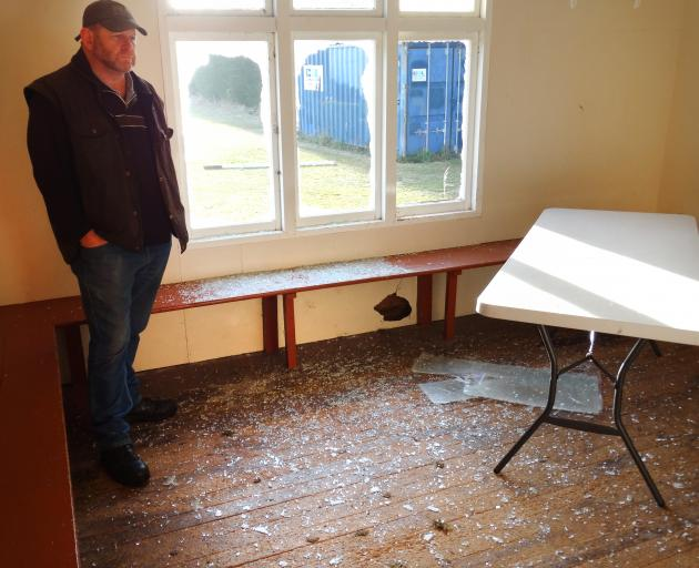 Waitaki Boys' High School property manager Neil Conway inspects damage to the school's cricket pavilion, which was vandalised on Monday night or  early yesterday. Photo: Daniel Birchfield