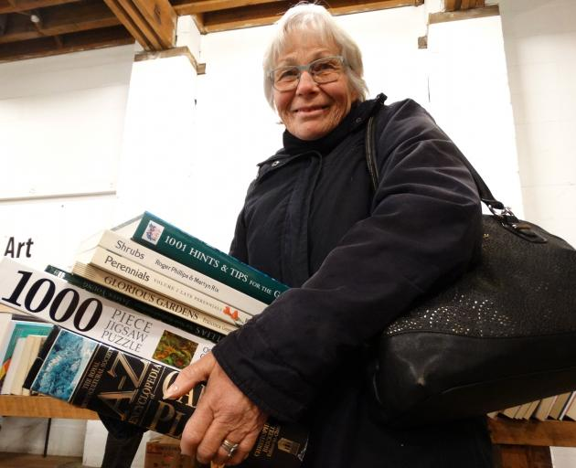 Wendy Smith, of Oamaru, holds her haul of finds at the Rotary Club of Oamaru Bookarama yesterday.