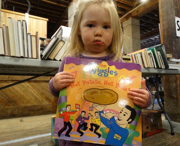 Charlotte Coursey (2), of Oamaru, holds a Wiggles book. PHOTOS: DANIEL BIRCHFIELD