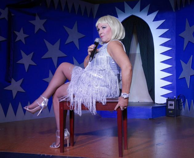 Barbara O'Brien, as Geri Halliwell, strikes a pose before she performs at Papakaio Stars in Your...