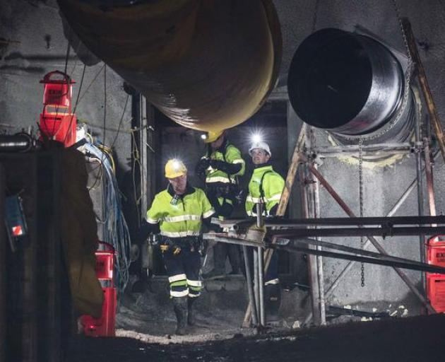 Geotechnical engineer Chris Lee, Mine Deputy Kirk Neilson and Chief Operating Officer Dinghy Pattinson opening the doors to the mine in May. Photo: Supplied: Pike River Recovery Agency