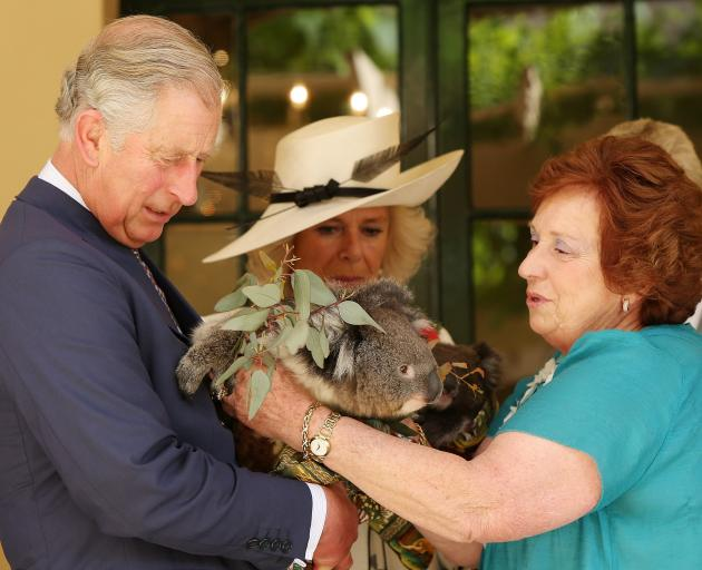 Camilla, Duchess of Cornwall, and Prince Charles, Prince of Wales, hold koalas with Koala rescue...