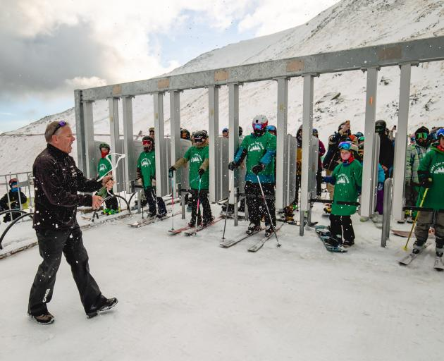 The Remarkables ski area manager Ross Lawrence pops the bubbly on Saturday. Ready to ride the...